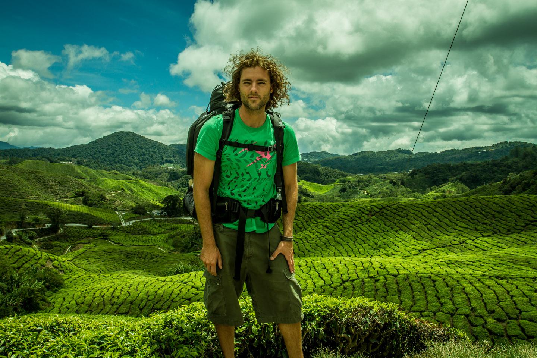 Backpacker Nico Sebastian Hopp with backpack on his trip around Cameron Highlands Malaysia