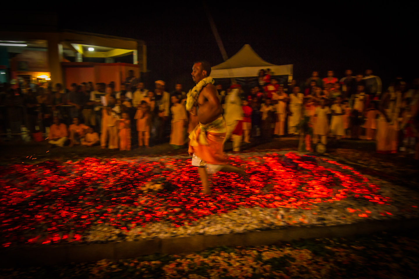 Walking over fire coals at Marche sur le feu firewalk La Reunion