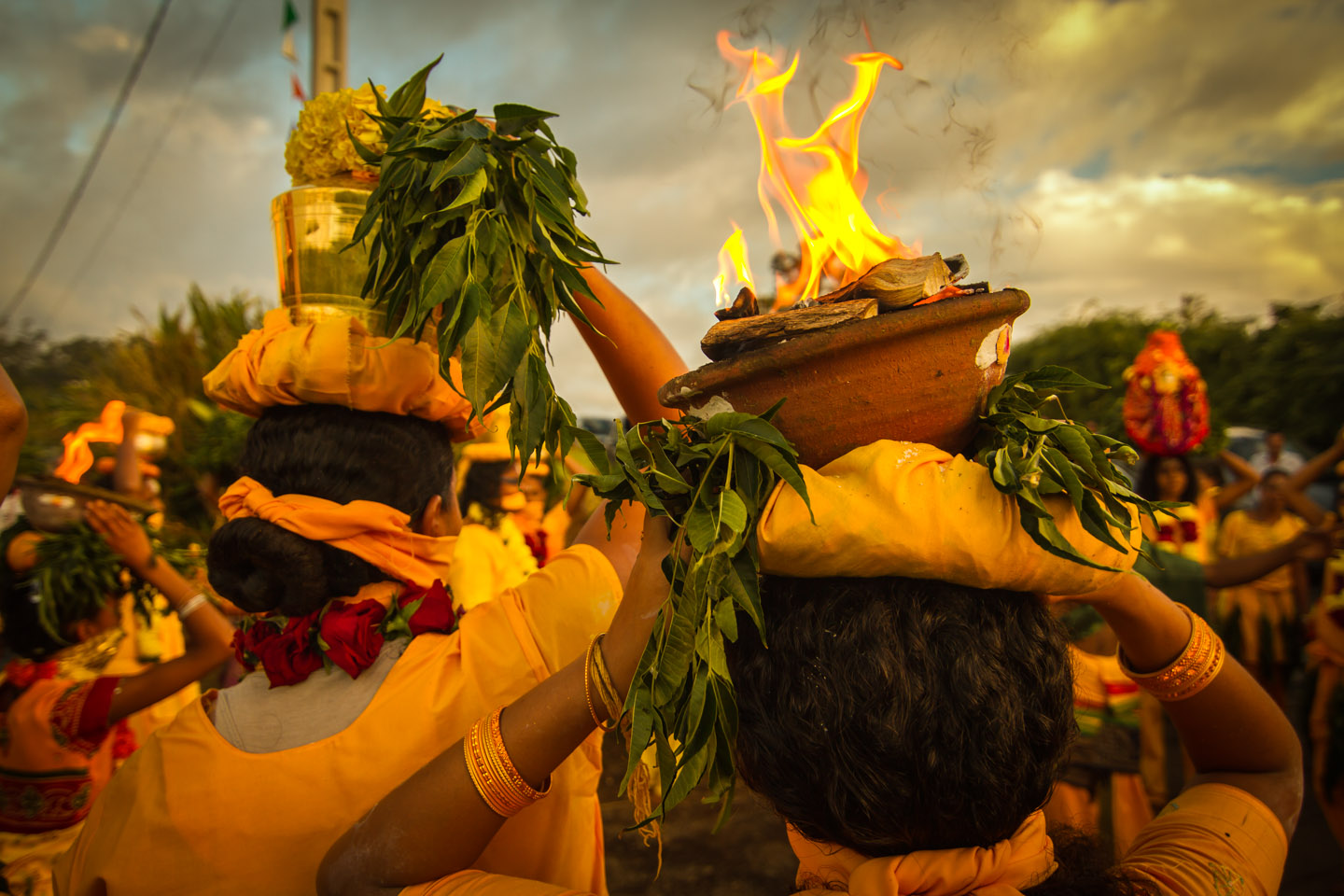 Tamil women carrying fire bowls at Marche sur le feu firewalk La Reunion