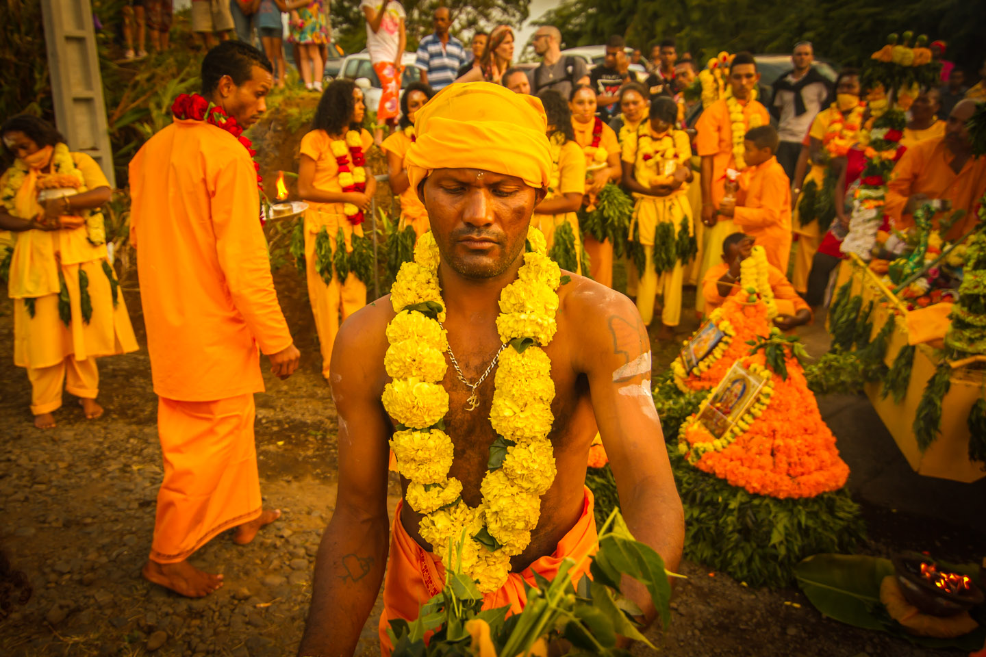 Tamil Hindu with flowers at Marche sur le feu firewalk La Reunion