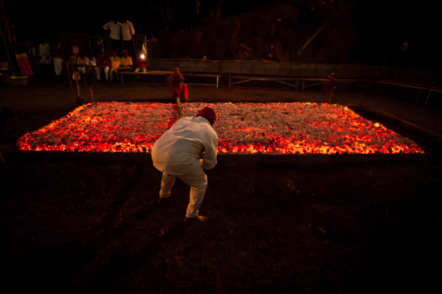 Preparing the red-hot coals for Marche sur le feu firewalk La Reunion