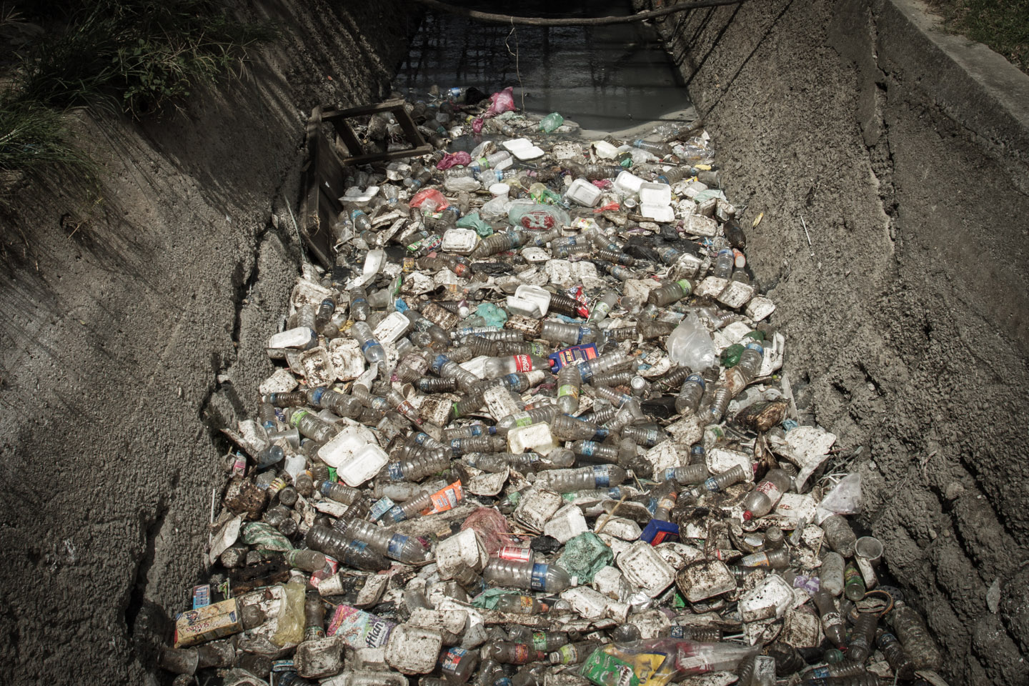 Waste dumped into a small river in Lahad Datu, Borneo, Sabah, Malaysia