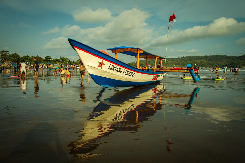 Traditional Indonesian boat trip ferry at Pangandaran beach Java Indonesia Indonesien