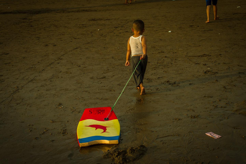 Young bodyboarder boy at surf spot Pangandaran surfing beach Java Indonesia Indonesien