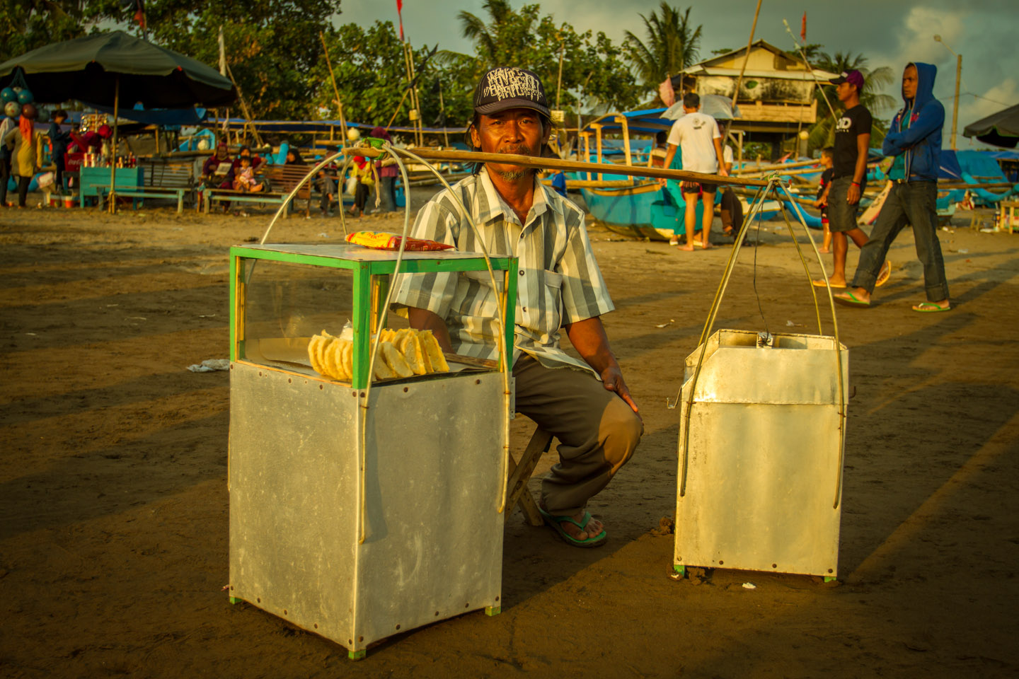Street vendor selling Pisang Goreng during Ramadan Idul Fitri Pangandaran Java Indonesia Indonesien