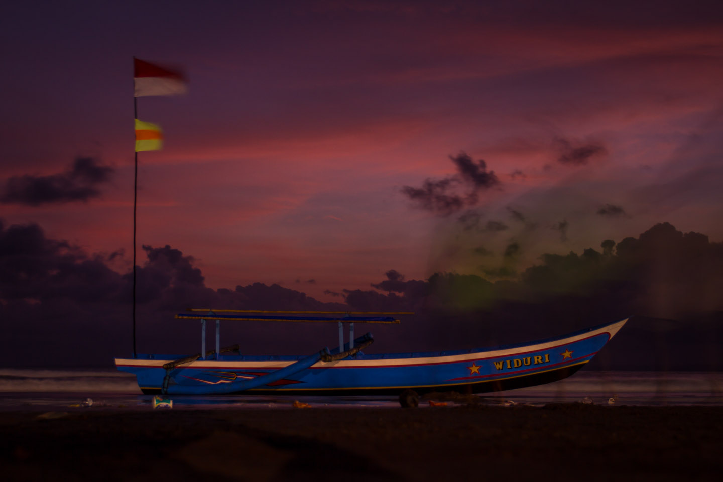 Traditional wooden boat on the beach of Pangandaran Java Indonesia Indonesien during sunset