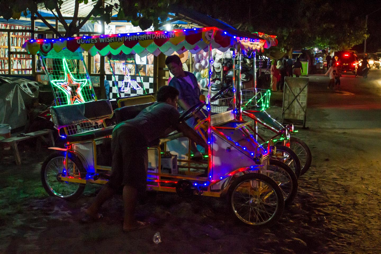 Ramadan Idul Fitri night at Pangandaran Java Indonesia with led light bicycles Indonesien