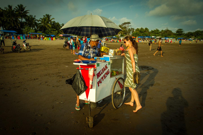 Anita Kisiala buying fruits from beach vendor at Pangandaran Java Indonesia Indonesien