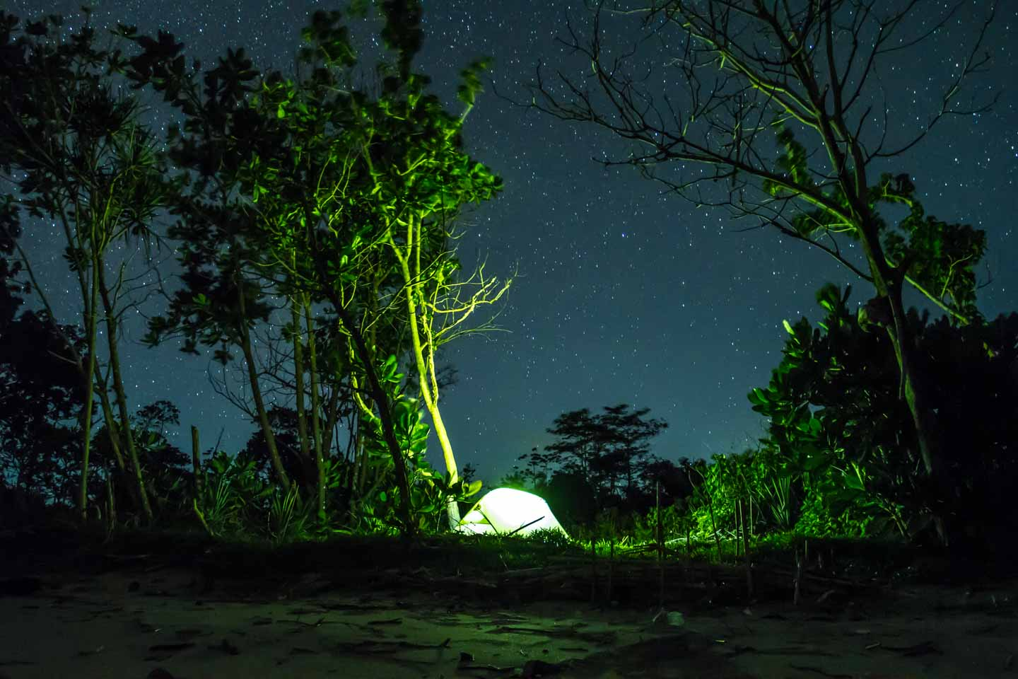 Our MSR Hubba Hubba HP tent at night and stars on the beach in Java